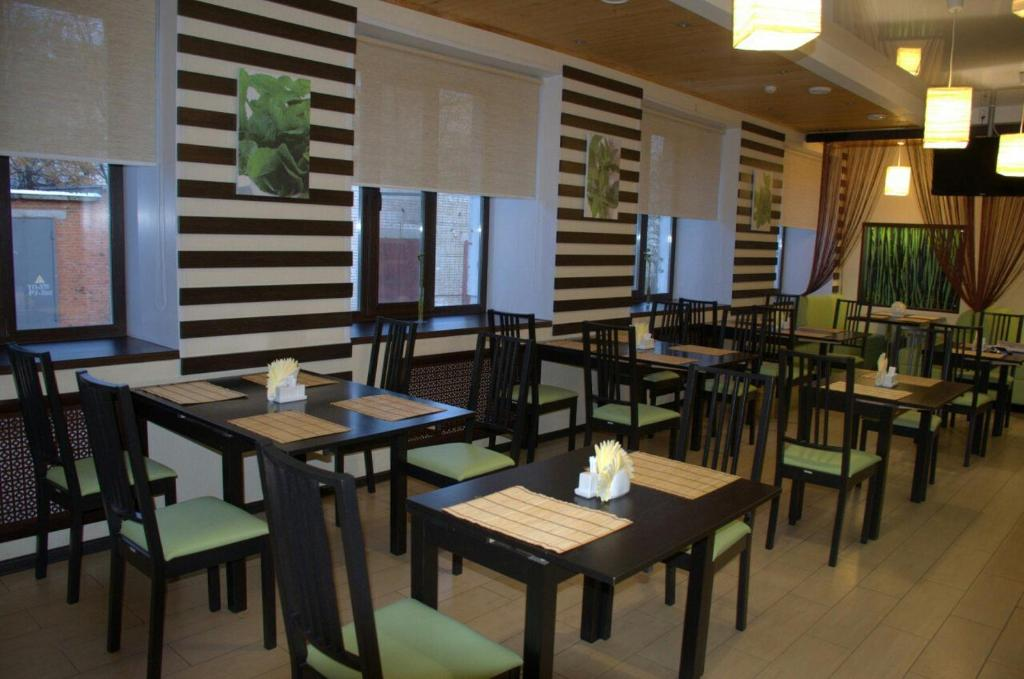 A restaurant or other place to eat at Hotel Veda
