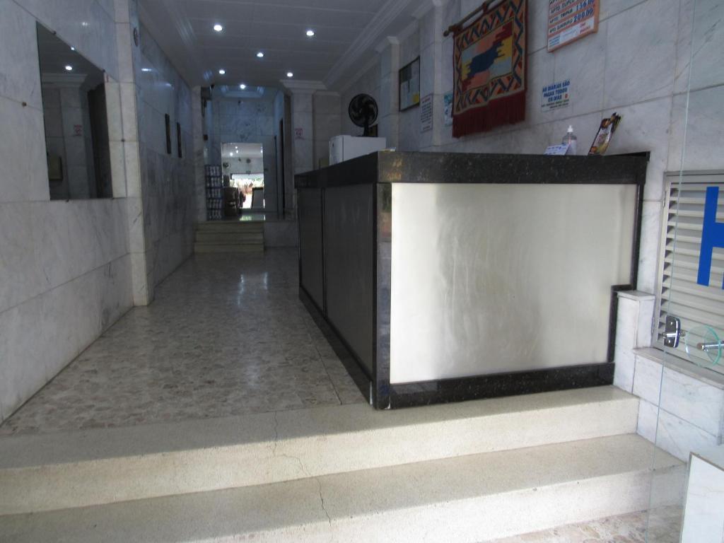 O saguão ou recepção de Hotel Moraes