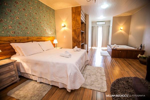Cama ou camas em um quarto em Pousada Pedra Preta