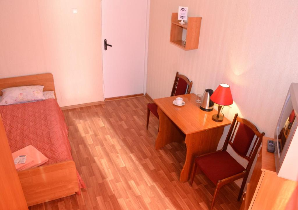 Гостиная зона в Гостиница Веда