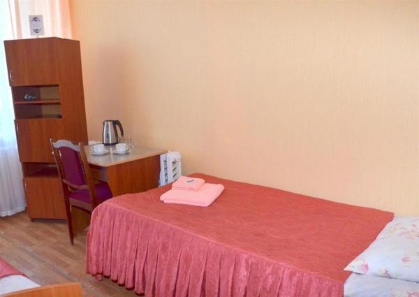 Кровать или кровати в номере Гостиница Веда