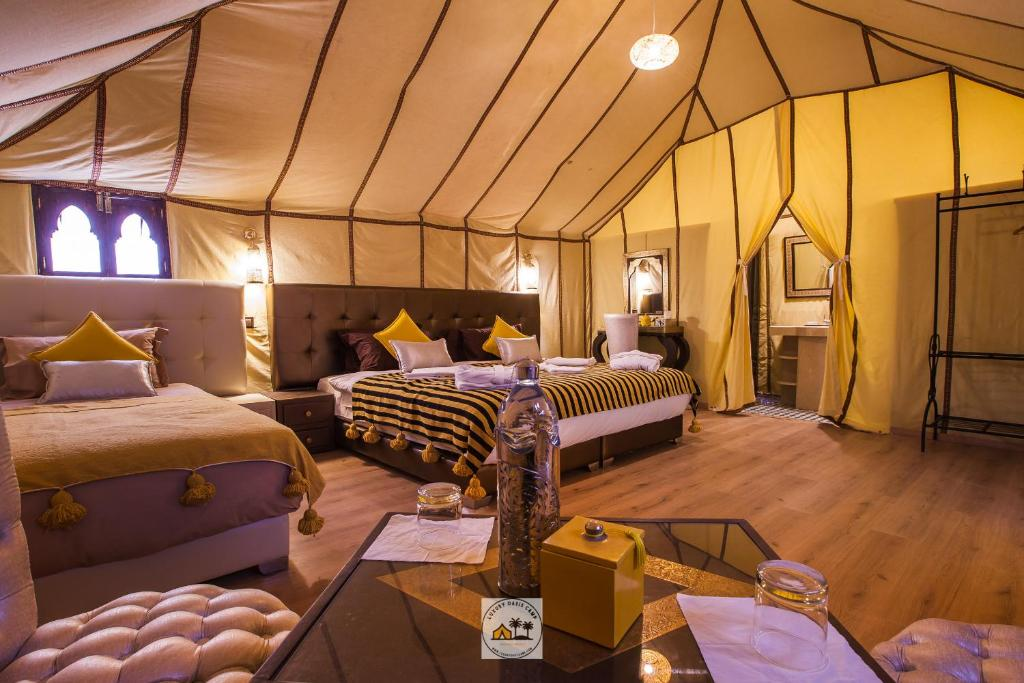 A bed or beds in a room at Luxury oasis camp