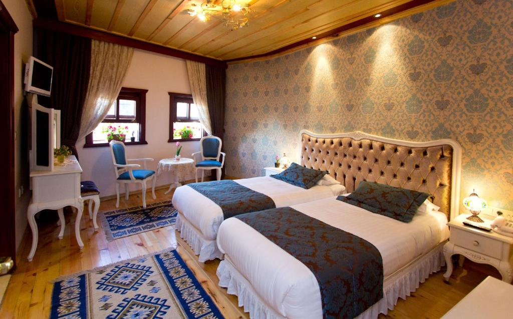 A bed or beds in a room at Esans Hotel - Special Category