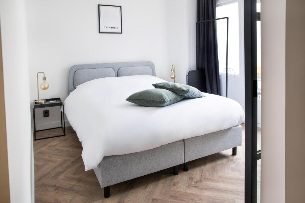 A bed or beds in a room at Maison BON Apartment