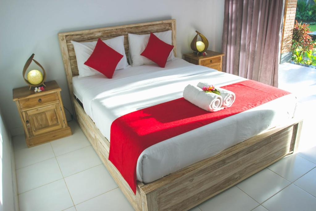 A bed or beds in a room at Taju Guest House