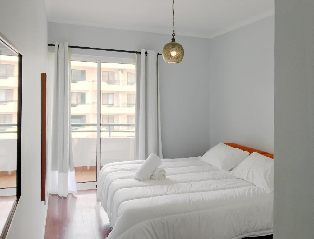 Cama o camas de una habitación en Ajuda Charming Apartment