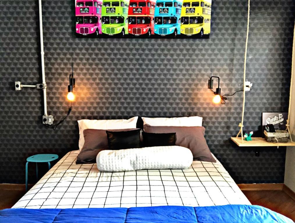 A bed or beds in a room at Casa dos Gattos - Guest House - Próx ao Aeroporto