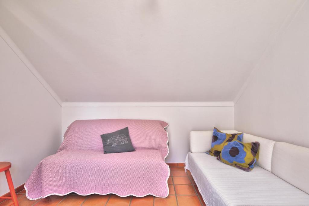 Uma cama ou camas num quarto em Casa Do Bico