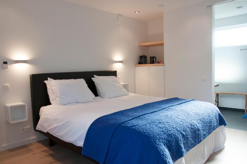 Un ou plusieurs lits dans un hébergement de l'établissement B&B Aquavit