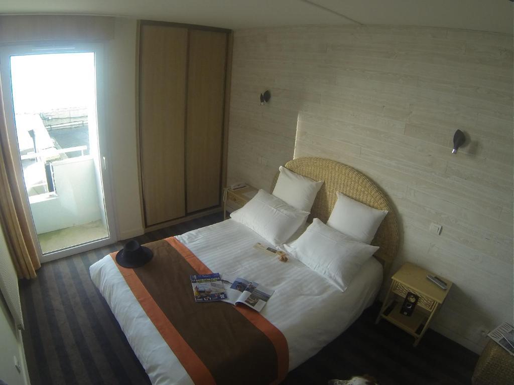 Ein Bett oder Betten in einem Zimmer der Unterkunft Hôtel Restaurant L'Empreinte