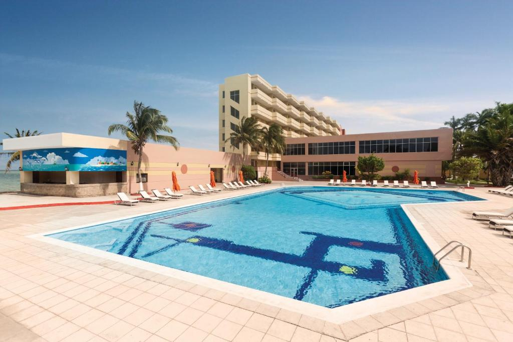 The swimming pool at or near Ramada by Wyndham Princess Belize City