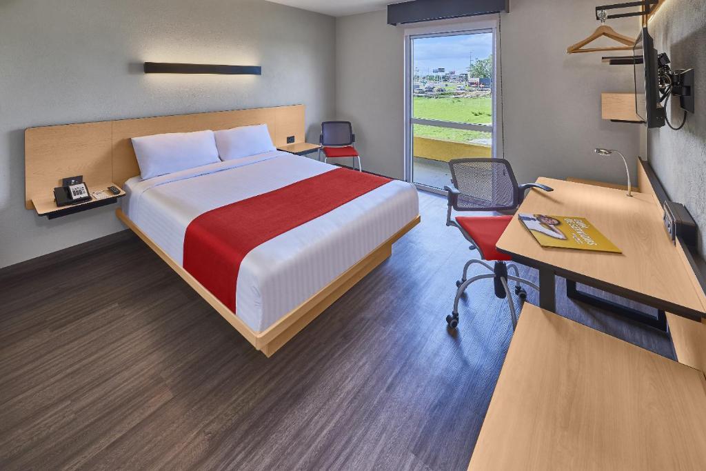 Cama o camas de una habitación en City Express Atlixco