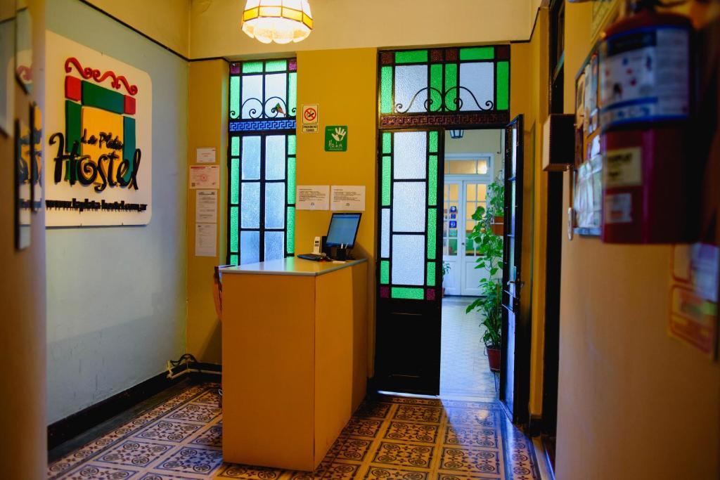 The lobby or reception area at La Plata Hostel
