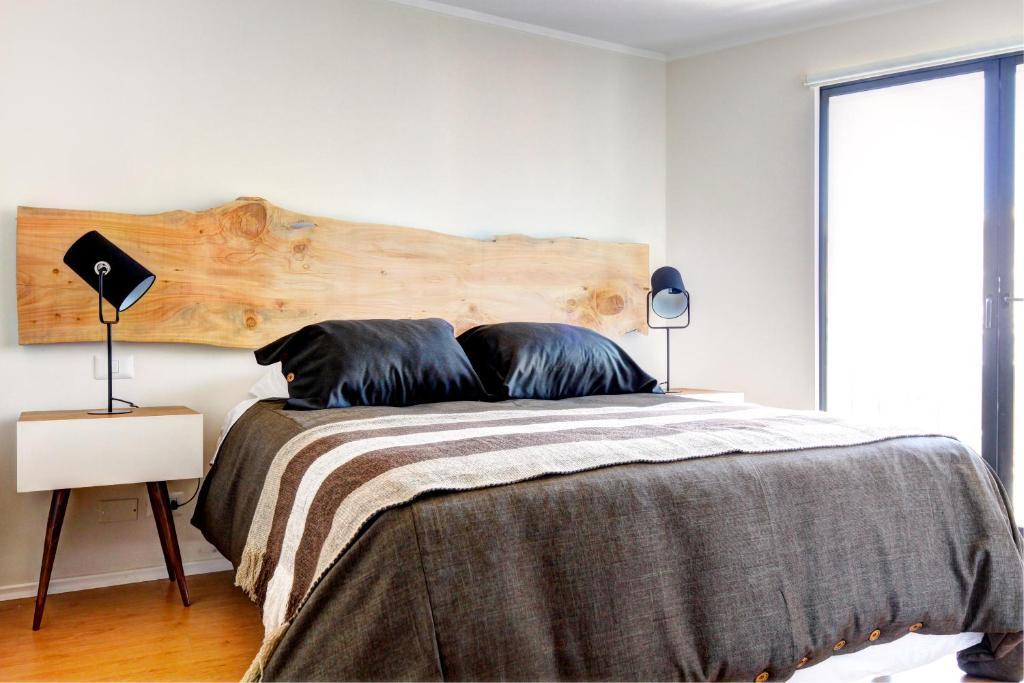 Cama o camas de una habitación en Rukaza Lastarria Apartments