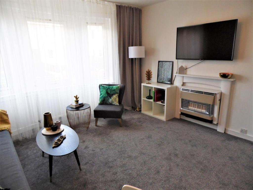 A television and/or entertainment center at Signature - Fitzalan View