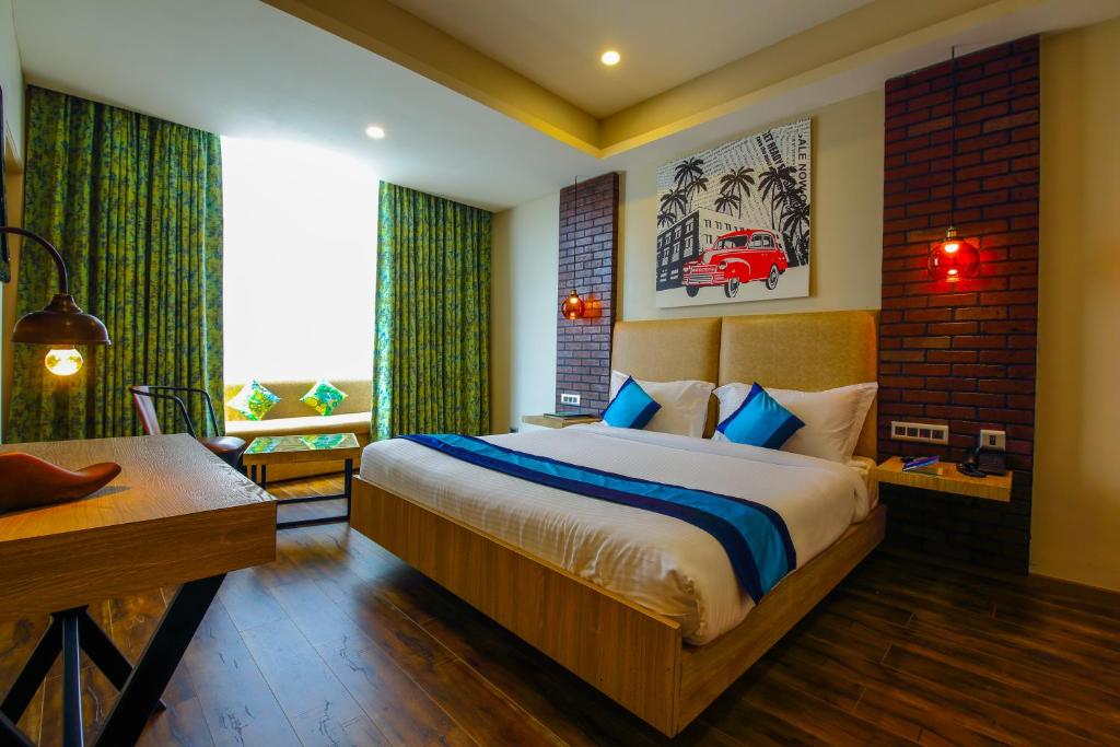 A bed or beds in a room at Hotel Mint OTM