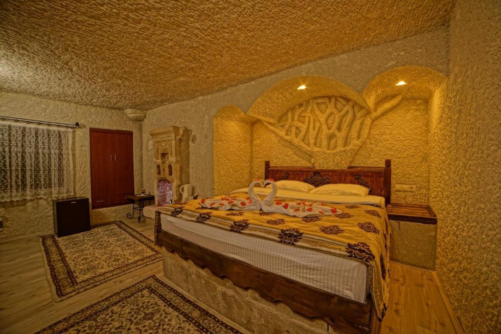 Кровать или кровати в номере Melek Cave Hotel