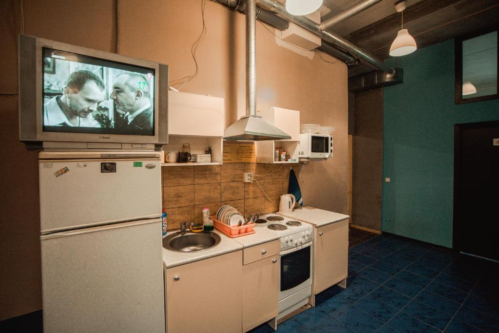 A kitchen or kitchenette at А 54 Hostel