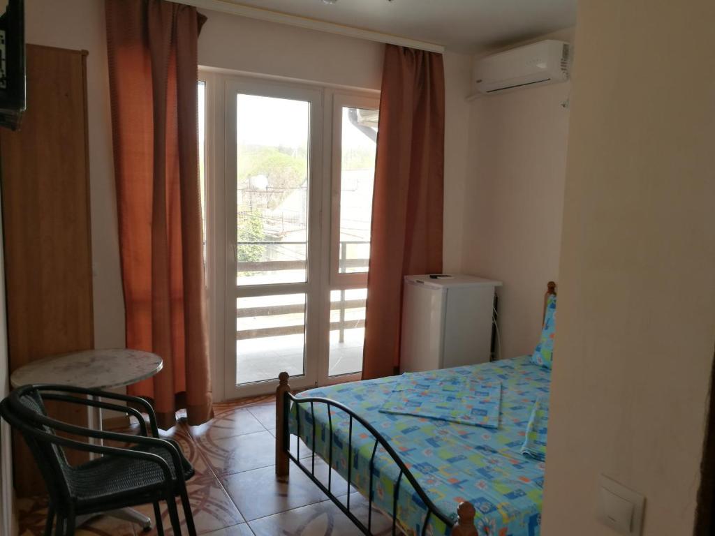 Кровать или кровати в номере Avangard Guest House
