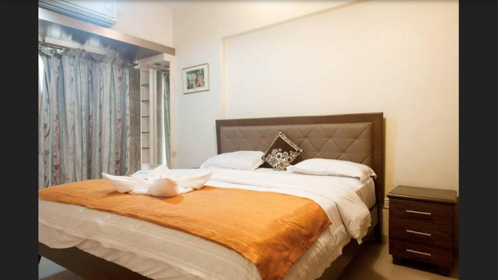 A bed or beds in a room at BSS - Pluto near IIT Powai