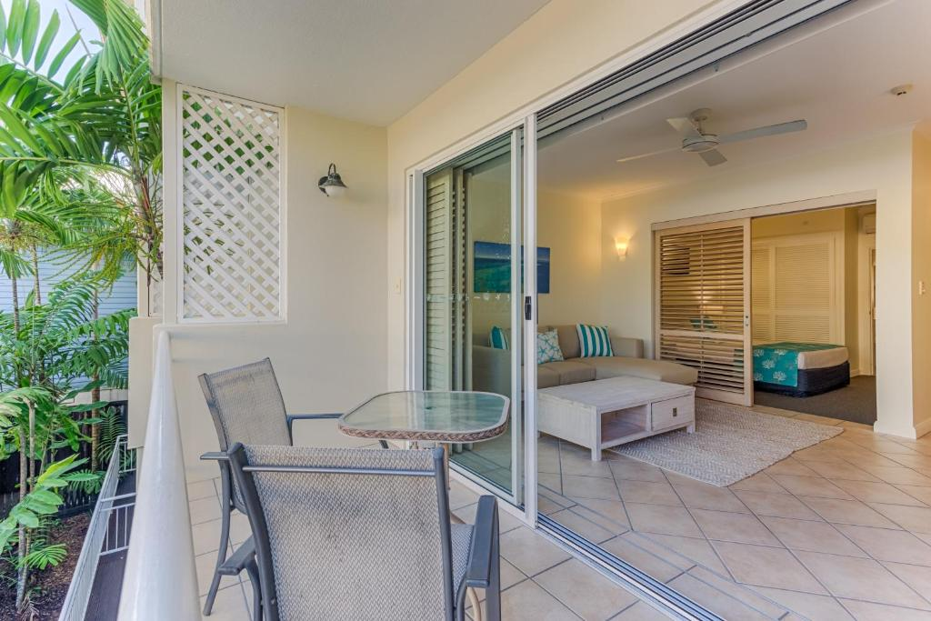 A balcony or terrace at Macrossan House Boutique Holiday Apartments