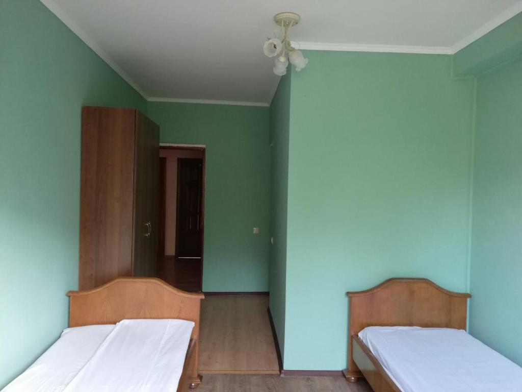 Кровать или кровати в номере Гостевой Дом Ассоль