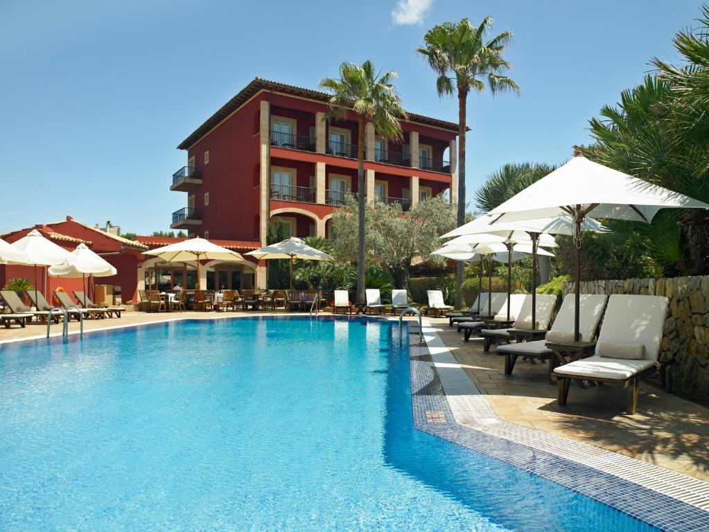 The swimming pool at or near Hotel Cala Sant Vicenç - Adults Only