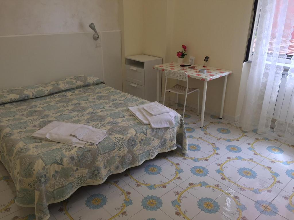 A bed or beds in a room at Albergo Oasi