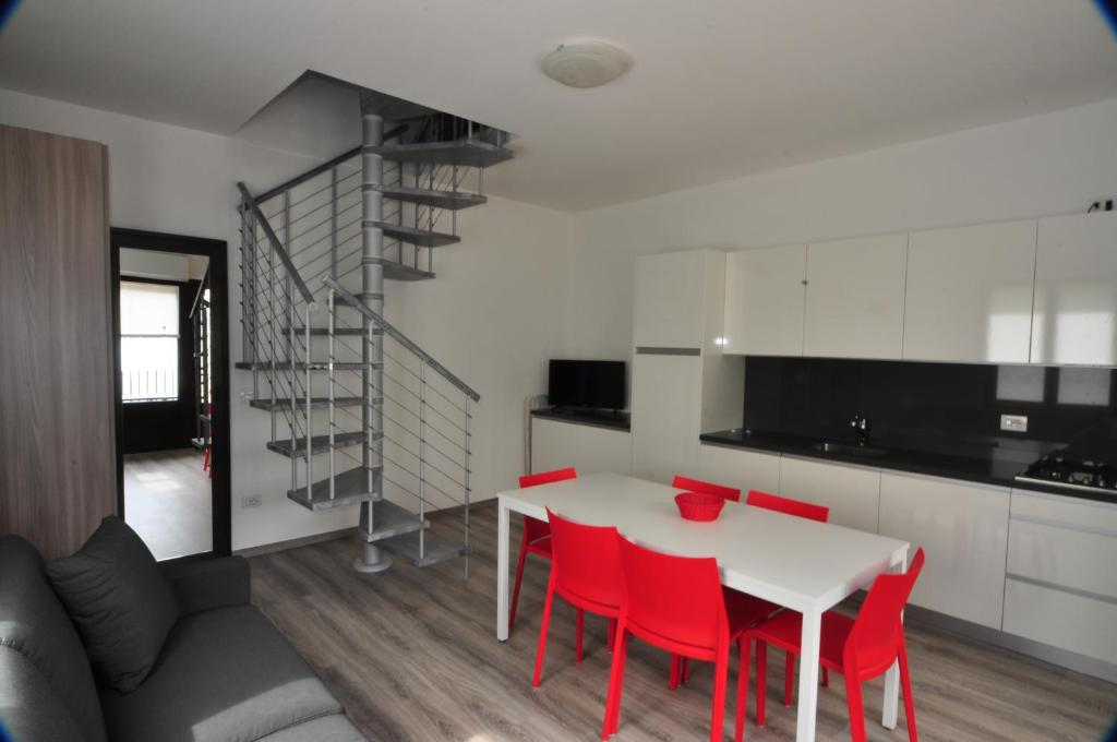 A kitchen or kitchenette at North Wind Camping & Apartment