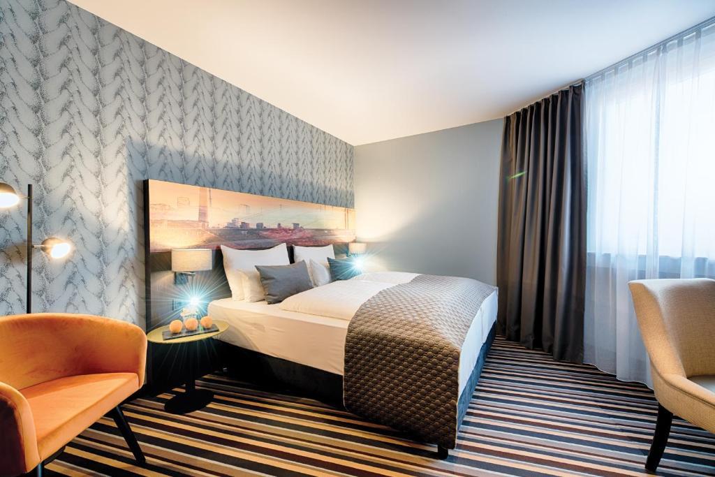 เตียงในห้องที่ Leonardo Boutique Hotel Düsseldorf