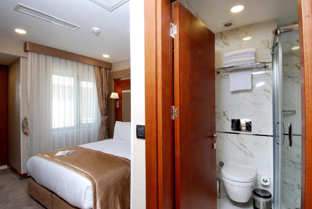 Ванная комната в Dosso Dossi Hotels Old City