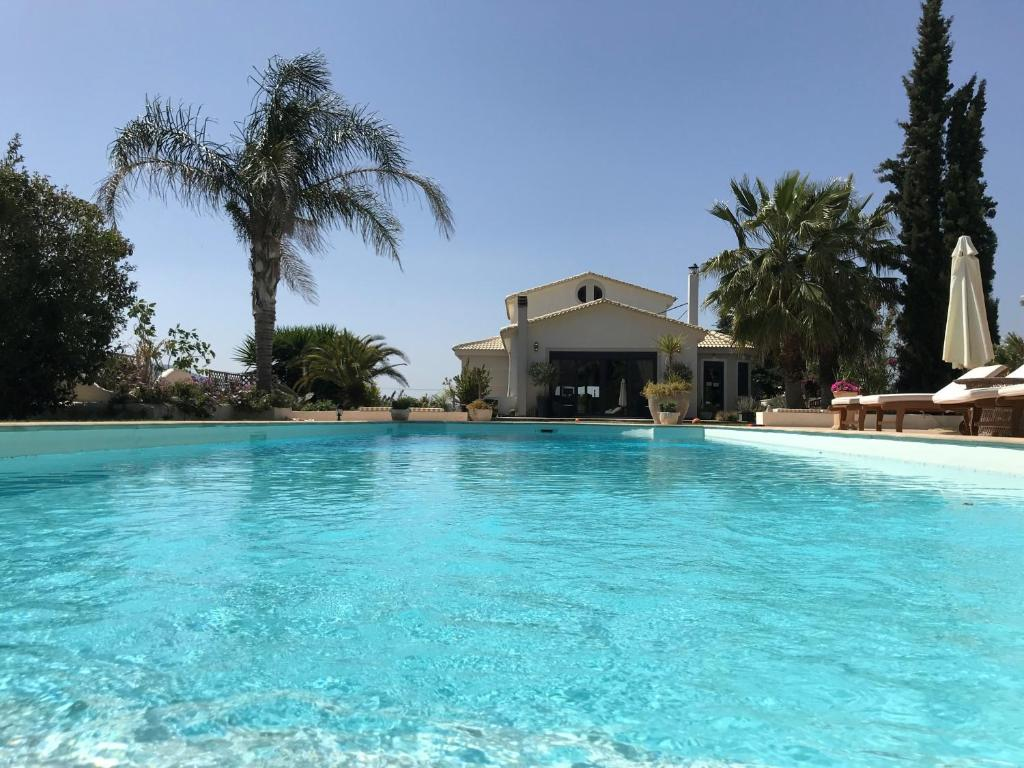 The swimming pool at or near Villa Vravrona Tower & Suites