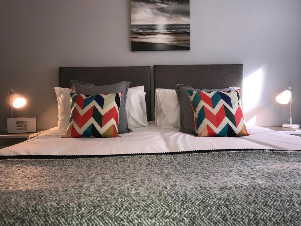 Krevet ili kreveti u jedinici u okviru objekta The Garden Apartment