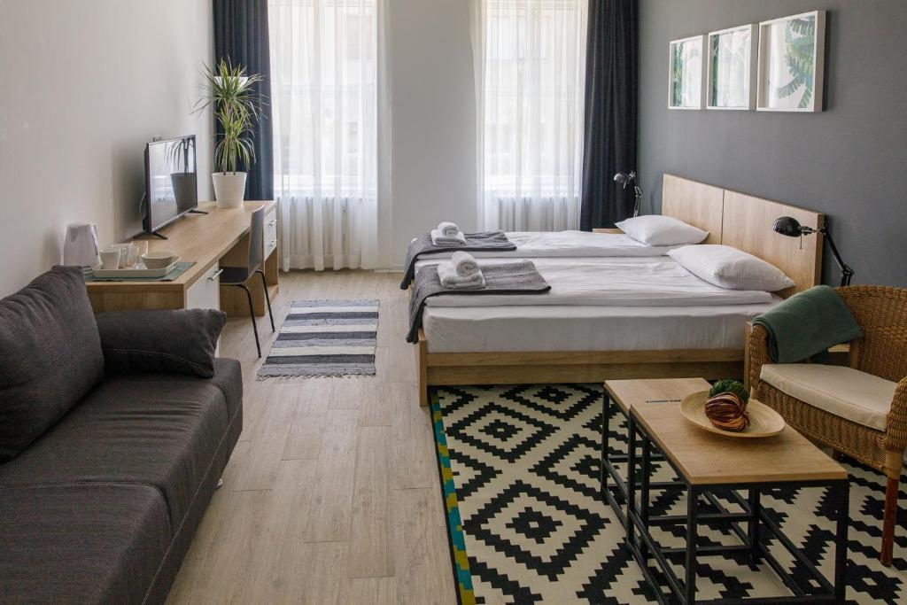 A bed or beds in a room at Arhiv