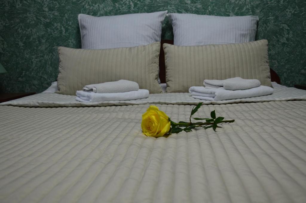 Кровать или кровати в номере Речная Долина