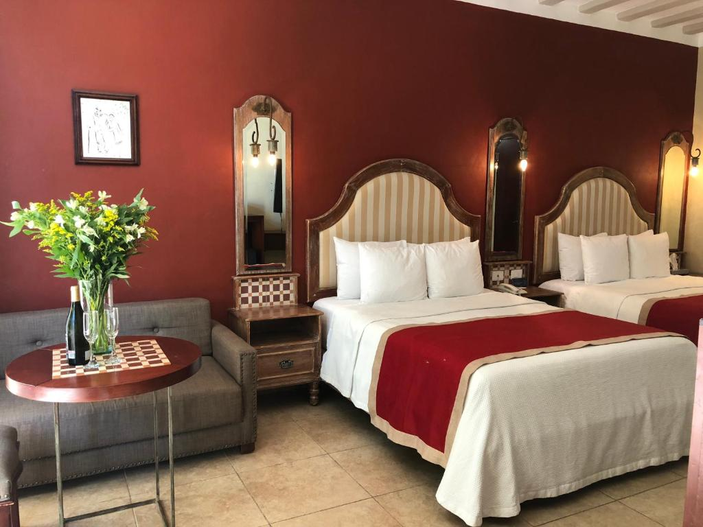 A bed or beds in a room at Casa Italia Luxury Guest House - Adults Only