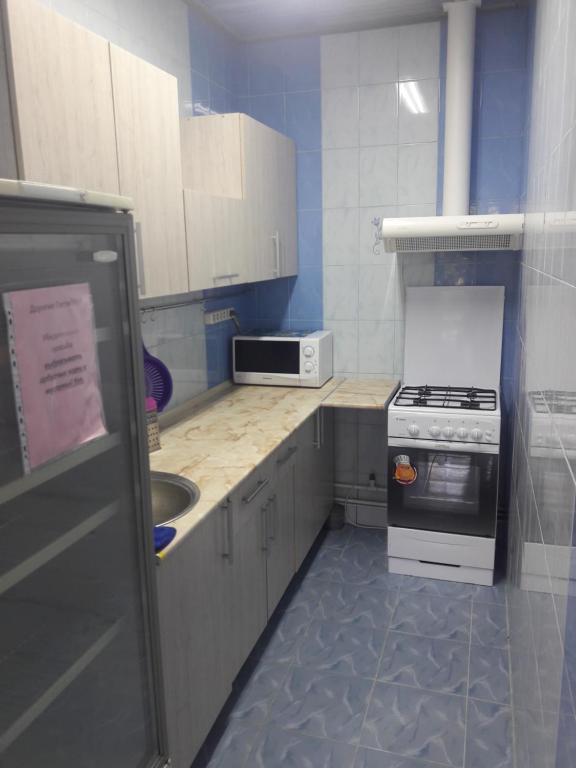 Кухня или мини-кухня в Радужный Отель