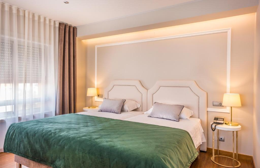 Cama o camas de una habitación en Imperhotel
