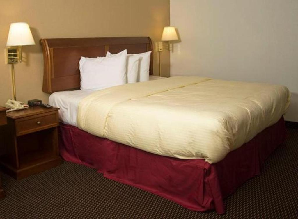 A bed or beds in a room at Express Inn & Suites