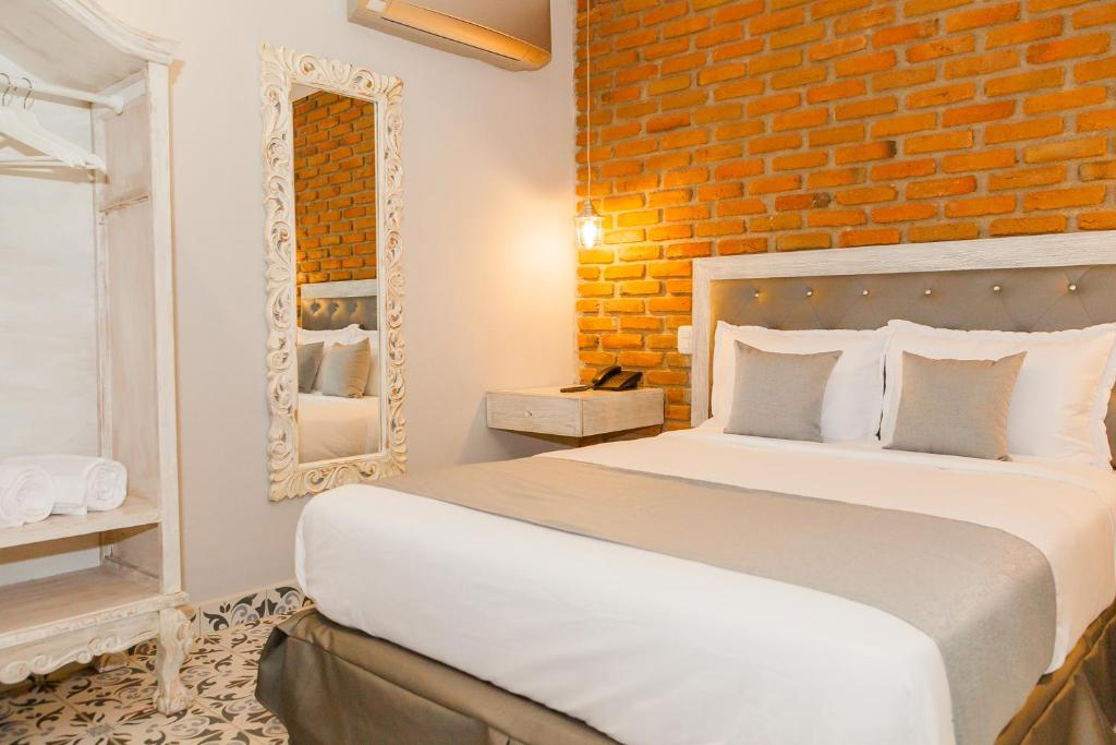 A bed or beds in a room at Adaz Hotel