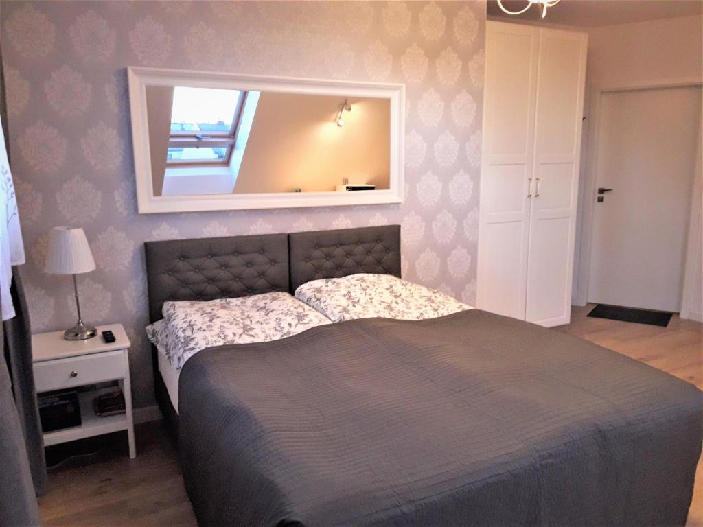 Łóżko lub łóżka w pokoju w obiekcie Pietrzak Apartments