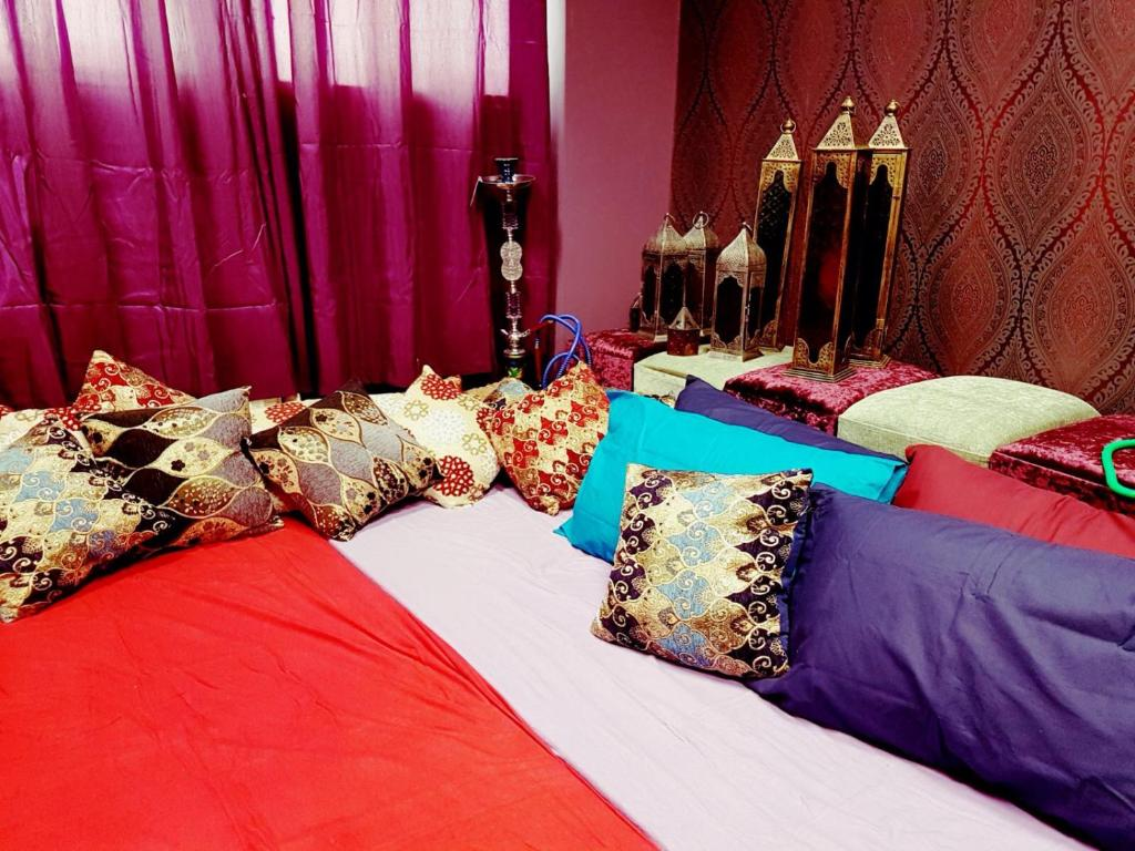 A bed or beds in a room at Manchester Party Pad