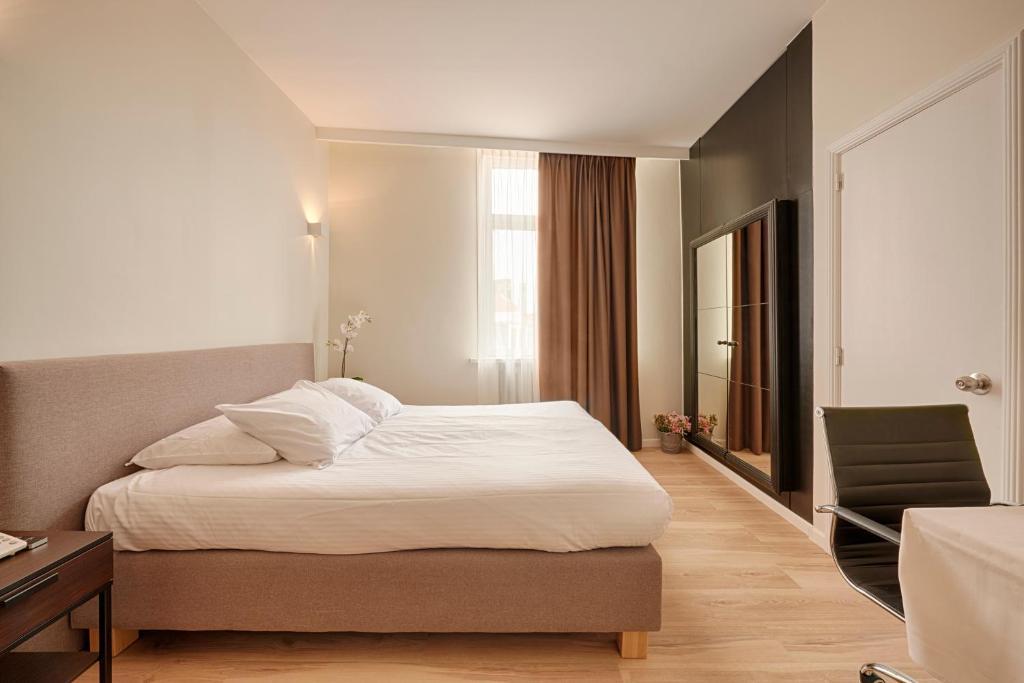 Uma cama ou camas num quarto em Hotel 't Putje