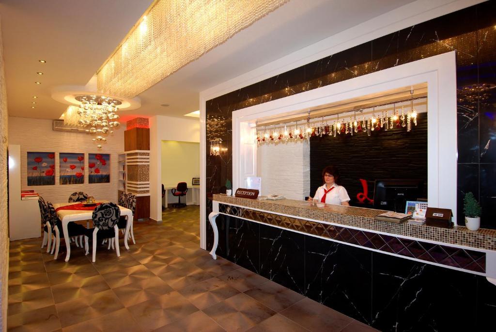 Лобби или стойка регистрации в Hatipoglu Beach Hotel