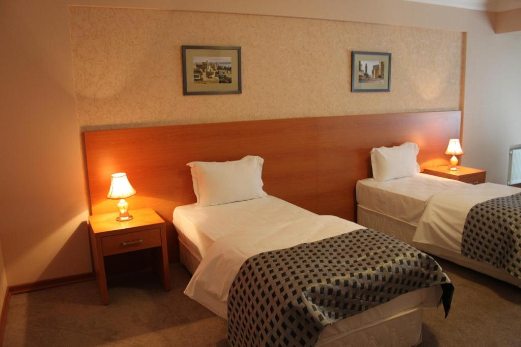 A bed or beds in a room at Gallery Hotel Baku