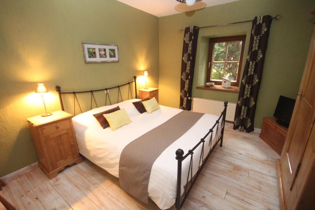 Un ou plusieurs lits dans un hébergement de l'établissement Le Petit Gîte de Durbuy