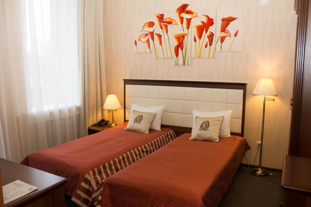 Кровать или кровати в номере Отель Минин на улице Пожарского
