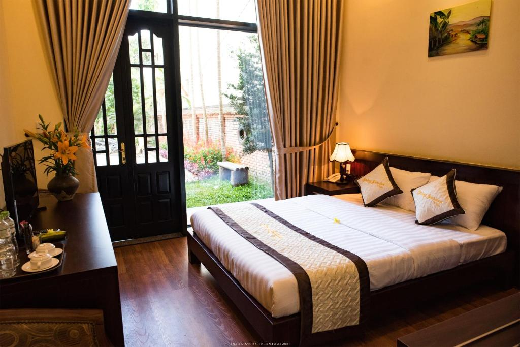 A bed or beds in a room at Spring Garden Villa