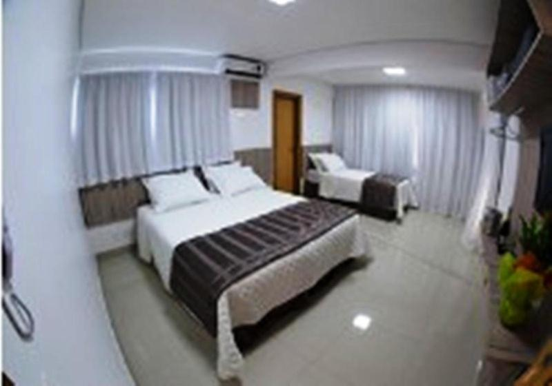 A bed or beds in a room at Hotel Conexão Pampulha