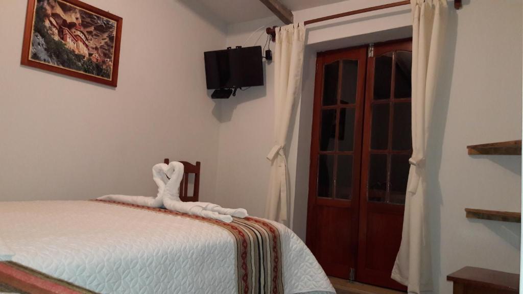 Łóżko lub łóżka w pokoju w obiekcie Gallito de las Rocas